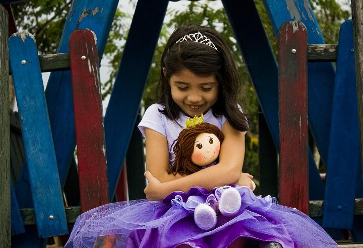 hugging doll girl child