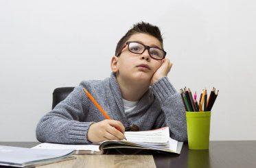 Child Struggling To Do Homework | Junk Mail